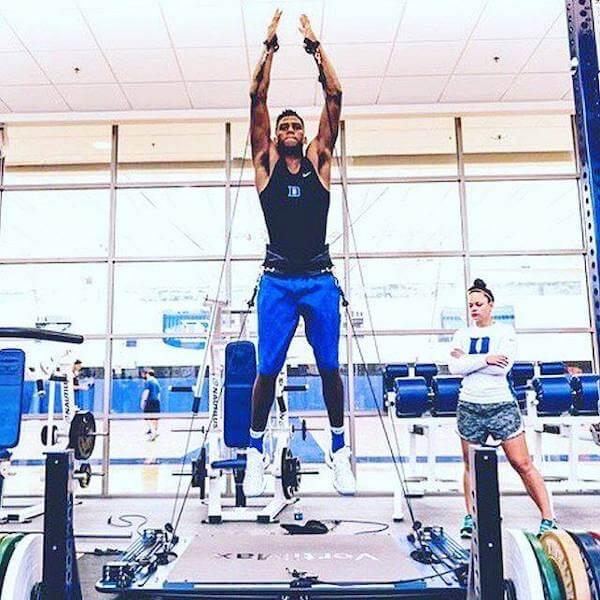 basketball player performing vertical jumps on vertimax v8