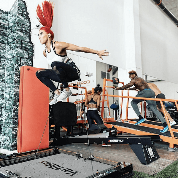 woman with red hair training on vertimax athletic conditioning equipment