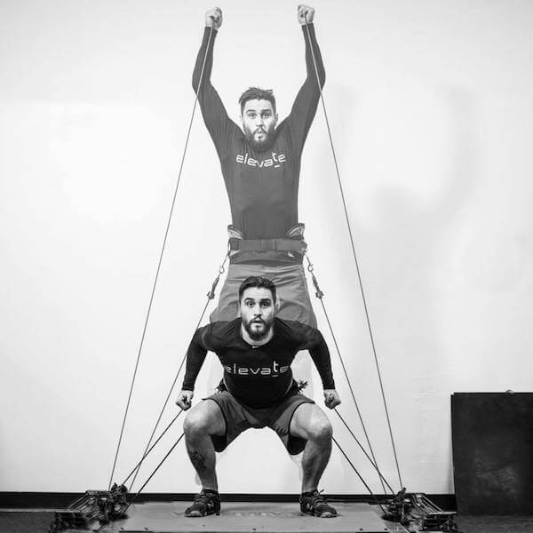 man training vertical jump on vertimax v8 equipment