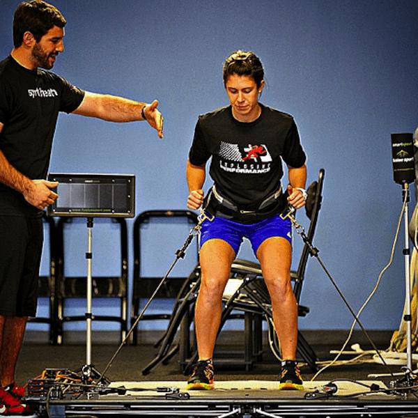coach teaching athlete-specific drills on sports training equipment