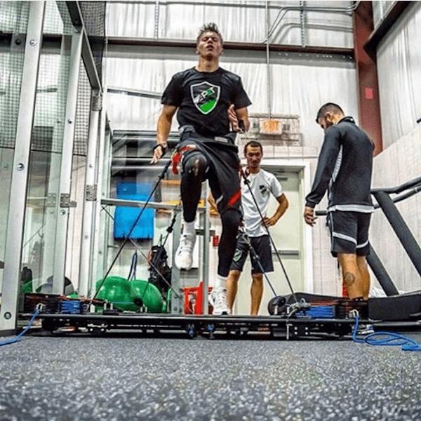 athletes taking turns training on vertimax training equipment