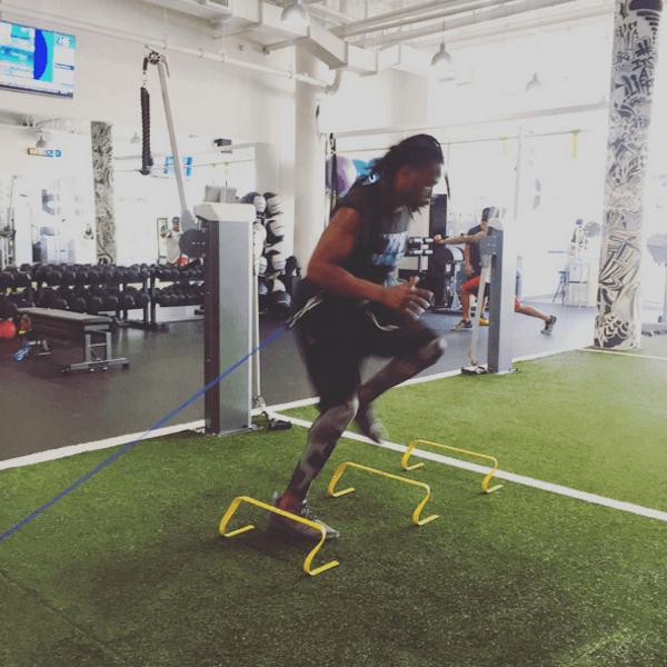 football player running vertical drills on vertimax v8 speed training equipment