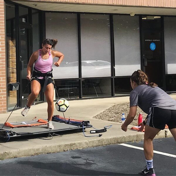 young soccer players training on vertimax v8 soccer training equipment