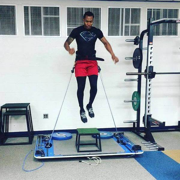 quarterback greg mcghee suspended in the air while training vertical jump