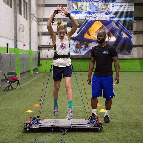 outside hitter using vertimax volleyball training equipment to increase vertical jump